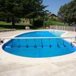 Cobertor solar térmico de piscina familiar forma irregular - Iber Coverpool